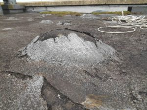 flat roof maintenance - blister