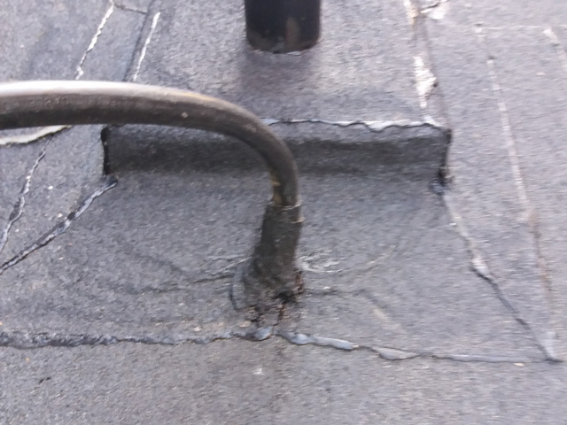 Putting a Cable Through a School Flat Roof – How Not to Invalidate Your Warranty