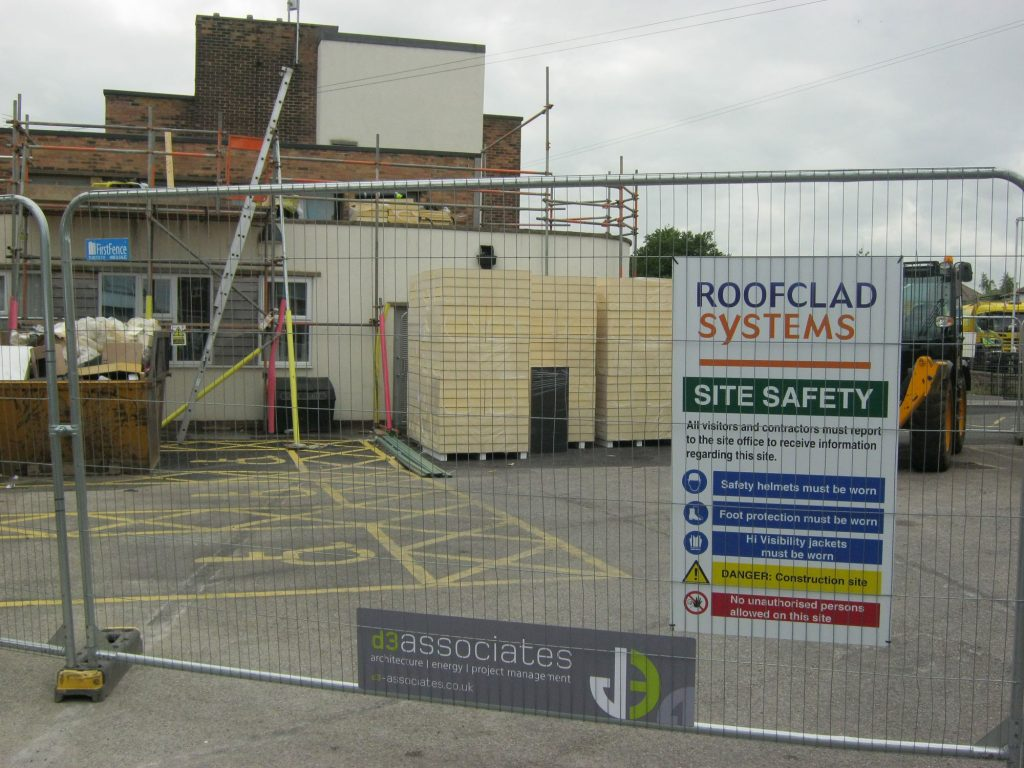 reroofing a school building during term time - site access