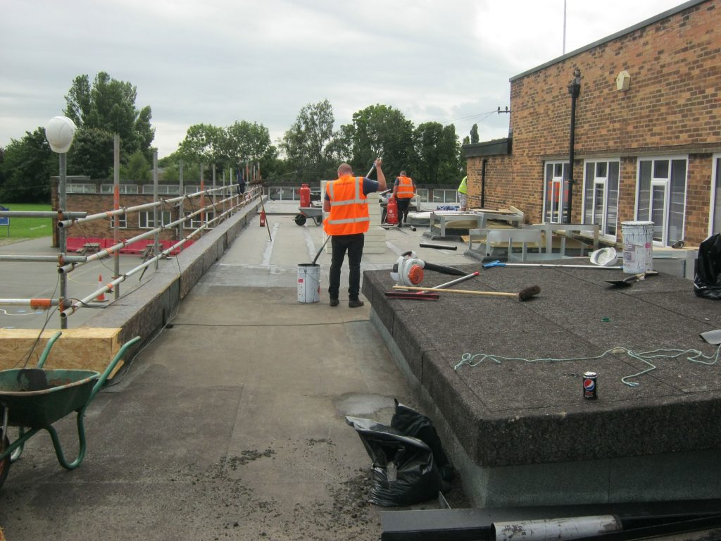 reroofing a school building during term time - perimeter scaffolding