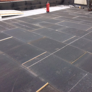 Stagger bonded insulation: Flat Roof On Site Inspection