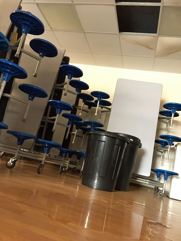 School Dining Room with Leaks Bucket - CIF Funding Too Late